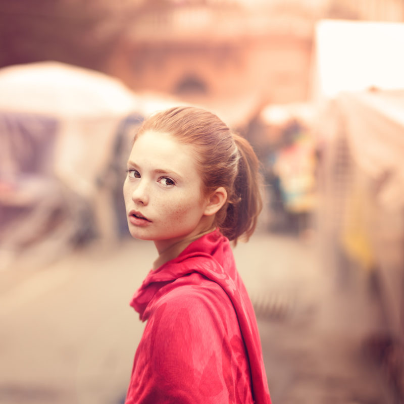 retro portrait of a beautiful girl on the street of town